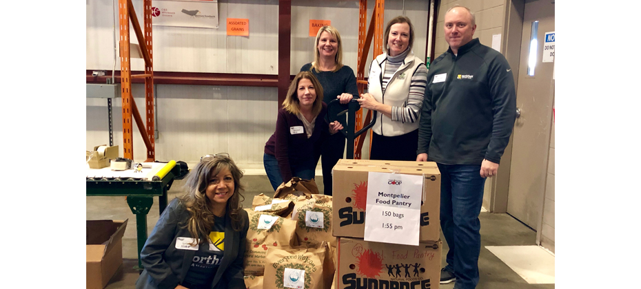 Northfield Savings Bank employees Nubia Fuller, Maryellen LaPerle, Wendy Kellett, Ava Whitcomb, Mark Mast (pictured left to right) helped pack grocery bags full of healthy food items to donate to local organizations that distribute to our neighbors in need.