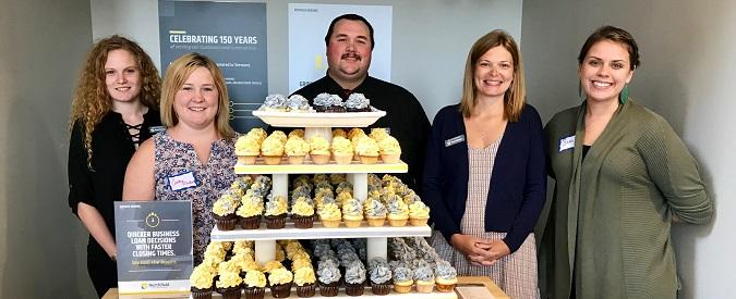 NSB staff with branded cupcakes